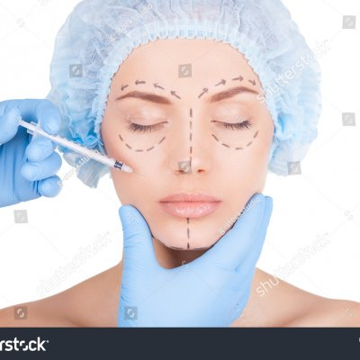 stock-photo-doing-a-botox-injection-beautiful-young-shirtless-woman-in-medical-headwear-and-sketches-on-face-173425148
